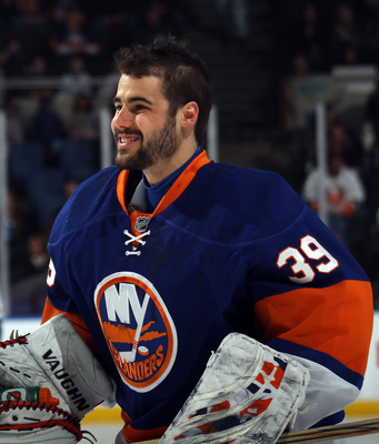 UNIONDALE, NY - JANUARY 15:  Rick DiPietro #39 of the New York Islanders in a game against the Buffalo Sabres at the Nassau Coliseum on January 15, 2011 in Uniondale, New York. The Islanders won 5-3. (Photo by Bruce Bennett/Getty Images)