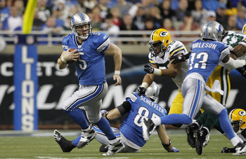 DETROIT - DECEMBER 12:  Drew Stanton #5 of the Detroit Lions runs for a first down during the the game against the Green Bay Packers at Ford Field on December 12, 2010 in Detroit, Michigan. The Lions defeated the Packers 7-3.  (Photo by Leon Halip/Getty I