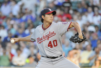 CHICAGO, IL - AUGUST 09:  Starting pitcher Chien-Ming Wang #40 of the Washington Nationals delivers during the first inning against the Chicago Cubs at Wrigley Field on August 9, 2011 in Chicago, Illinois.  (Photo by Brian Kersey/Getty Images)