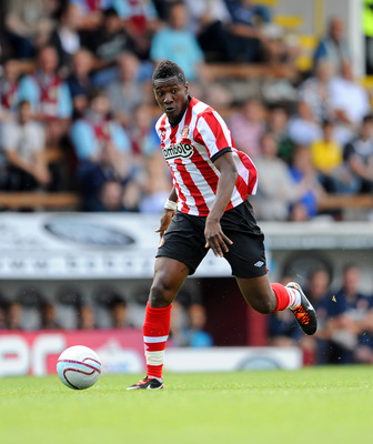 BURNLEY, UNITED KINGDOM - JULY 30: Asamoah Gyan of Sunderland in action during the pre season friendly match between Burnley and Sunderland at Turf Moor on July 30, 2011 in Burnley, England. (Photo by Clint Hughes/Getty Images)