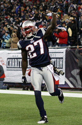 FOXBORO, MA - DECEMBER 19:  Cornerback Kyle Arrington #27 of the New England Patriots celebrates scoring a touchdown after intercepting the ball and running 36 yards against the Green Bay Packers during the third quarter of the game at Gillette Stadium on