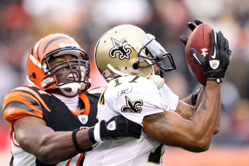 CINCINNATI, OH - DECEMBER 05: Robert Meachem #17 of the New Orleans Saints catches pass while defended by Chinedum Ndukwe #41 of the Cincinnati Bengals during the NFL game at Paul Brown Stadium on December 5, 2010 in Cincinnati, Ohio.  The Saints won 34-3