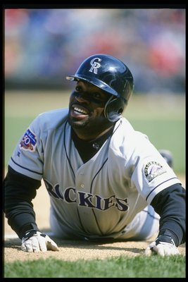 16 Apr 1997: Runner Eric Young of the Colorado Rockies slides into a base during the Rockies 4-0 win over the Chicago Cubsat Wrigley Field in Chicago, Illinois.