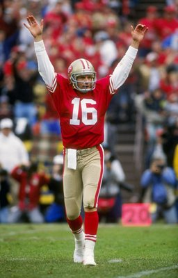 13 Jan 1991:  Quarterback Joe Montana of the San Francisco 49ers raises his hands in celebration after throwing a touch down pass in the 49ers 28-10 victory over the Washington Redskins at RFK Stadium in Washington D.C. Mandatory Credit: Otto Greule Jr.