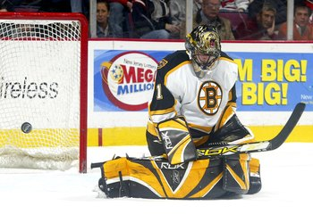 EAST RUTHERFORD, NJ- MARCH 24 : Andrew Raycroft #1 of the Boston Bruins makes a blocker save as the puck flies to his right during their game against the New Jersey Devils at the Continental Airlines Arena on March 24, 2006 in East Rutherford, New Jersey.