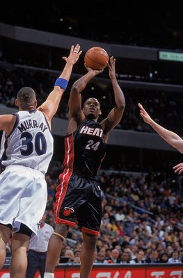 26 Feb 2000: Jamal Mashburn #24 of the Miami Heat makes a jump shot as he is guarded by Tracy Murray #30 of the Washington Wizards at the MCI Center in Washington, D.C. The Heat defeated the Wizards 98-88..    Mandatory Credit: Doug Pensinger  /Allsport