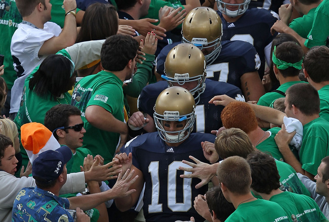 SOUTH BEND, IN - SEPTEMBER 04: Starting quarterback Dayne Crist #10 of the Notre Dame Fighting Irish leads players to the field through the student section for warm-ups before a game against the Purdue Boilermakers at Notre Dame Stadium on September 4, 20