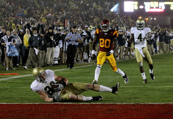 LOS ANGELES - NOVEMBER 27:  Safety Harrison Smith #22 of the Notre Dame Fighting Irish comes down with the interception onf the one yard line to end the final drive in the final minute by the USC Trojans at the Los Angeles Memorial Coliseum on November 27
