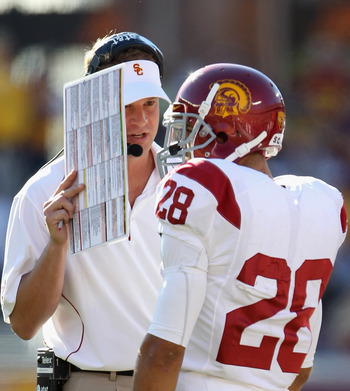Lane Kiffin counsels RB Dillon Baxter during game in 2010