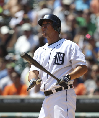 DETROIT - JULY 31:  Magglio Ordonez #30 of the Detroit Tigers hits a two run home run scoring Don Kelly #32 off Jered Weaver #36 Los Angeles Angels of Anaheim at Comerica Park on July 31, 2011 in Detroit, Michigan.  (Photo by Leon Halip/Getty Images)