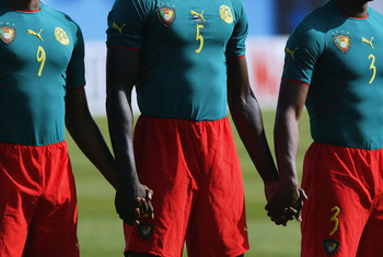 MONASTIR, TUNISIA- FEBRUARY 8:  The Cameroon team line-up in their one peace kit before the African Nations Cup 2004 1/4 Final  match between Cameroon and Nigeria at the Mustapha Ben Jannet Stadium on February 8, 2004 in Monastir, Tunisia.  (Photo by Shau