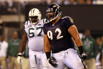 EAST RUTHERFORD, NJ - SEPTEMBER 13:  Haloti Ngata #92 of the Baltimore Ravens celebrates after a play against the New York Jets during their Jets home opener at the New Meadowlands Stadium on September 13, 2010 in East Rutherford, New Jersey.  (Photo by J