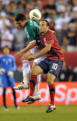 PHILADELPHIA, PA- AUGUST 10: Landon Donovan #10 of the United States and Hector Moreno #15 of Mexico battle to head the ball at Lincoln Financial Field on August 10, 2011 in Philadelphia, Pennsylvania. (Photo by Drew Hallowell/Getty Images)