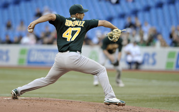 TORONTO, CANADA - AUGUST 10:  Gio Gonzalez #47 of the Oakland Athletics delivers a pitch during MLB game action the Toronto Blue Jays August 10, 2011 at Rogers Centre in Toronto, Ontario, Canada. (Photo by Brad White/Getty Images)