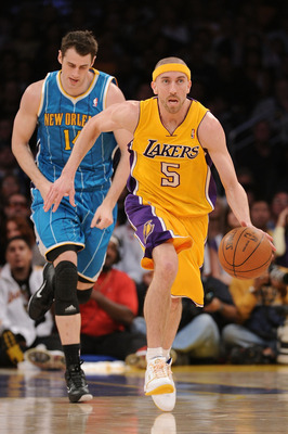 LOS ANGELES, CA - APRIL 20:  Steve Blake #5 of the Los Angeles Lakers moves the ball while taking on the New Orleans Hornets in Game Two of the Western Conference Quarterfinals in the 2011 NBA Playoffs on April 20, 2011 at Staples Center in Los Angeles, C