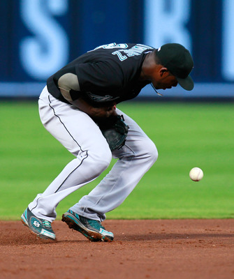 ATLANTA, GA - JULY 29:  Hanley Ramirez #2 of the Florida Marlins bobbles a line drive by Brandon Beachy #37 of the Atlanta Braves in the third inning at Turner Field on July 29, 2011 in Atlanta, Georgia.  (Photo by Kevin C. Cox/Getty Images)