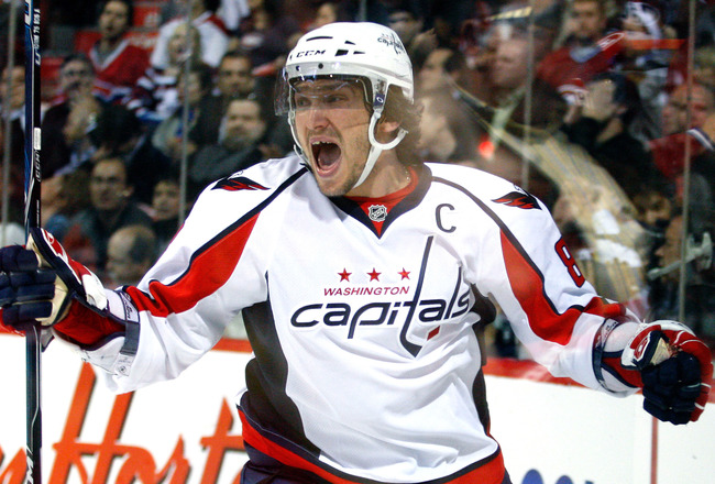 MONTREAL- APRIL 21:  Alex Ovechkin #8 of the Washington Capitals celebrates his first period goal in Game Four of the Eastern Conference Quarterfinals during the 2010 NHL Stanley Cup Playoffs against the Montreal Canadiens at the Bell Centre on April 21,
