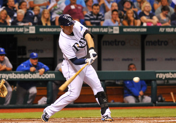 ST. PETERSBURG, FL - AUGUST 8:  Infielder Evan Longoria #3 of the Tampa Bay Rays singles against the Kansas City Royals August 8, 2011 at Tropicana Field in St. Petersburg, Florida. (Photo by Al Messerschmidt/Getty Images)