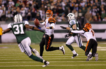 EAST RUTHERFORD, NJ - NOVEMBER 25:  Quarterback Carson Palmer #9 of the Cincinnati Bengals throws a pass under pressure from Jim Leonhard #36 of the New York Jets at New Meadowlands Stadium on November 25, 2010 in East Rutherford, New Jersey. The Jets def