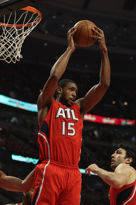 CHICAGO, IL - MAY 10: Al Horford #15 of the Atlanta Hawks grabs a rebound against the Chicago Bulls in Game Five of the Eastern Conference Semifinals in the 2011 NBA Playoffs at the United Center on May 10, 2011 in Chicago, Illinois. The Bulls defeated th