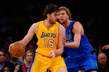 LOS ANGELES, CA - MAY 04:  Pau Gasol #16 of the Los Angeles Lakers posts up Dirk Nowitzki #41 of the Dallas Mavericks in the first quarter in Game Two of the Western Conference Semifinals in the 2011 NBA Playoffs at Staples Center on May 4, 2011 in Los An