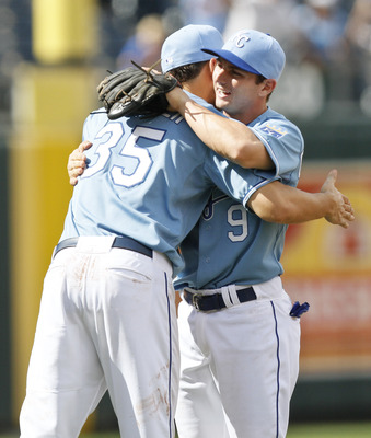 KANSAS CITY, MO - AUGUST 07: Second baseman Johnny Giavotella #9 and Eric Hosmer #35 of the Kansas City Royals celebrate their 4-3 win over the Detroit Tigers at Kauffman Stadium on August 7, 2011 in Kansas City, Missouri. The Royals won 4-3. (Photo by Ed