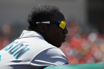 ANAHEIM, CA - AUGUST 07:  Trayvon Robinson #12 of the Seattle Mariners looks on from the dugout as his team bats against the Los Angeles Angels of Anaheim on August 7, 2011 at Angel Stadium in Anaheim, California.  The Angels won 2-1.  (Photo by Stephen D