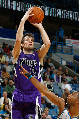 NEW ORLEANS, LA - DECEMBER 15:  Beno Udrih #19 of the Sacramento Kings shoots the ball over Willie Green #33 of the New Orleans Hornets  at the New Orleans Arena on December 15, 2010 in New Orleans, Louisiana.  The Hornets defeated the Kings 94-91.  NOTE