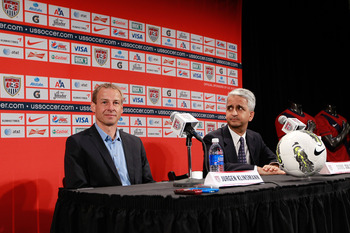 NEW YORK, NY - AUGUST 01:  (L) Jurgen Klinsmann and U.S. Soccer President (R) Sunil Gulati talk to the media during a press conference to announce Jurgen Klinsmann as the new head coach of the U.S. Mens National Team at NikeTown on August 1, 2011 in New