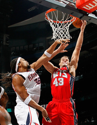 ATLANTA, GA - DECEMBER 07:  Etan Thomas #36 of the Atlanta Hawks defends the basket against Kris Humphries #43 of the New Jersey Nets at Philips Arena on December 7, 2010 in Atlanta, Georgia.  NOTE TO USER: User expressly acknowledges and agrees that, by
