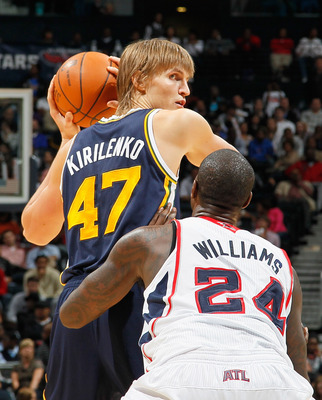 ATLANTA - NOVEMBER 12:  Andrei Kirilenko #47 of the Utah Jazz against Marvin Williams #24 of the Atlanta Hawks at Philips Arena on November 12, 2010 in Atlanta, Georgia.  NOTE TO USER: User expressly acknowledges and agrees that, by downloading and/or usi