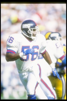 12 Nov 1989:  Linebacker Lawrence Taylor of the New York Giants moves down the field during a game against the Los Angeles Rams at Anaheim Stadium in Anaheim, California.  The Rams won the game, 31-10. Mandatory Credit: Mike Powell  /Allsport
