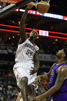 CHARLOTTE, NC - FEBRUARY 25:  DeMarcus Cousins #15 of the Sacramento Kings watches as Kwame Brown #54 of the Charlotte Bobcats dunks the ball during their game at Time Warner Cable Arena on February 25, 2011 in Charlotte, North Carolina. NOTE TO USER: Use