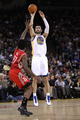 OAKLAND, CA - DECEMBER 20:  Vladimir Radmanovic #77 of the Golden State Warriors in action against the Houston Rockets at Oracle Arena on December 20, 2010 in Oakland, California. NOTE TO USER: User expressly acknowledges and agrees that, by downloading a