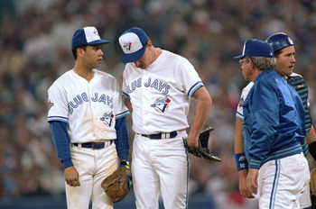 TORONTO - OCTOBER 22:  Roberto Alomar #12 of the Toronto Blue Jays (L) talks to his pitcher Jack Morris #47 during game 5 of the World Series aganst the Atlanta Braves at the SkyDome in Toronto, Ontario, Canada, on October 22, 1992. The Braves won 7-2. (P