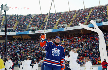 EDMONTON, CANADA - NOVEMBER 22:  Forward Esa Tikkanen #10 of the Edmonton Oilers acknowledges the fans as he skates into the rink to take on the Montreal Canadiens during the Molson Canadien Heritage Classic on November 22, 2003 at Commonwealth Stadium in