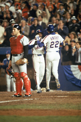 FLUSHING, NY - OCTOBER 27:  Third baseman Ray Knight #22 of the New York Mets gives teammate Mookie Wilson #1 a five during game 7 of the 1986 World Series against the Boston Red Sox at Shea Stadium in Flushing, New York. The Mets won the series 4-3.  (Ph