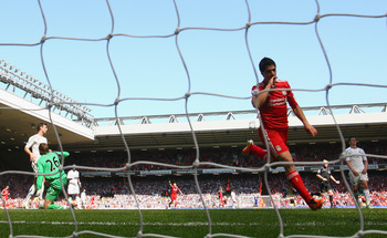 LIVERPOOL, ENGLAND - MAY 01:  Luis Suarez of Liverpool runs away to celebrate after scoring the third goal during the Barclays Premier League match between Liverpool  and Newcastle United at Anfield on May 1, 2011 in Liverpool, England.  (Photo by Clive B