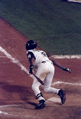 26 Oct 1997:  Shortstop Edgar Renteria of the Florida Marlins in action at the plate during the seventh game of the World Series against the Cleveland Indians at Pro Player Stadium in Miami, Florida.  The Marlins won the game 3-2 and took the series. Mand