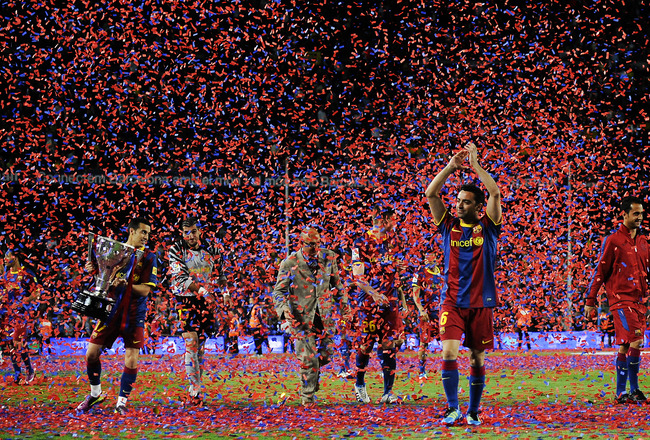 BARCELONA, SPAIN - MAY 15:  Xavi Hernandez of FC Barcelona (R) aknowledges spectators during the celebrations for winning La Liga after the La Liga match between Barcelona and Deportivo La Coruna at Camp Nou Stadium on May 15, 2011 in Barcelona, Spain.  (