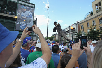 CHICAGO, IL - AUGUST 10:  Fans take photos of a statue of former Chicago Cub player and broadcaster Ron Santo which was unveiled before a game between the Cubs and the Washington Nationals at Wrigley Field on August 10, 2011 in Chicago, Illinois.  (Photo