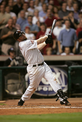 HOUSTON - OCTOBER 18:  First baseman Jeff Bagwell #5 of the Houston Astros swings at a St. Louis Cardinals pitch in game five of National League Championship Series during the 2004 Major League Baseball Playoffs on October 18, 2004 at Minute Maid Park in