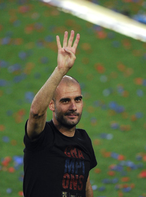 BARCELONA, SPAIN - MAY 29:  Head coach Josep Guardiola of FC Barcelona gestures during the celebrations after winning the UEFA Champions League Final against Manchester United, at Camp Nou Stadium on May 29, 2011 in Barcelona, Spain.  (Photo by David Ramo