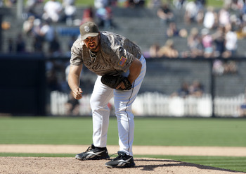 SAN DIEGO, CA - JULY 31: Pitcher Heath Bell #21 of the San Diego Padres prepares to throw the ball against the Colorado Rockies at Petco Park on July 31, 2011 in San Diego, California. (Photo by Kent C. Horner/Getty Images)