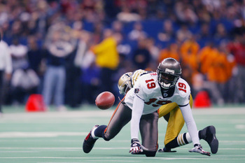 NEW ORLEANS - DECEMBER 1:  Keyshawn Johnson #19 of the Tampa Bay Buccanneers eyes the ball as he looks to catch the pass while falling to the turf against the New Orleans Saints on December 1, 2002 at the Louisiana Superdome in New Orleans, Louisiana.  Th