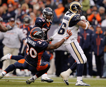 DENVER - NOVEMBER 28:  Tight end Michael Hoomanawanui #86 of the St. Louis Rams breaks away from safety Brian Dawkins #20 and Perrish Cox #32 of the Denver Broncos on his way to scoring a 36-yard touchdown in the first quarter at INVESCO Field at Mile Hig