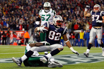 FOXBORO, MA - JANUARY 16:  Alge Crumpler #82 of the New England Patriots scores a touchdown against James Ihedigbo #44 of the New York Jets in the third quarter during their 2011 AFC divisional playoff game at Gillette Stadium on January 16, 2011 in Foxbo