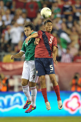PHILADELPHIA, PA - AUGUST 10: Michael Orozco Fiscal #5 of the United States and Omar Arellano #9 of Mexico go up to head the ball at Lincoln Financial Field on August 10, 2011 in Philadelphia, Pennsylvania. The game ended 1-1. (Photo by Drew Hallowell/Get