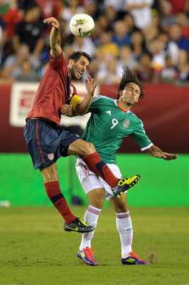 PHILADELPHIA, PA - AUGUST 10: Carlos Bocanegra #3 of the United States and Omar Arellano #9 of Mexico fight for the ball at Lincoln Financial Field on August 10, 2011 in Philadelphia, Pennsylvania. The game ended 1-1. (Photo by Drew Hallowell/Getty Images