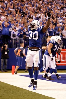 INDIANAPOLIS, IN - JANUARY 08:  Dominic Rhodes #30 of the Indianapolis Colts celebrates after Pierre Garcon #85 scored a 57-yard touchdown reception in the second quarter against the New York Jets during their 2011 AFC wild card playoff game at Lucas Oil